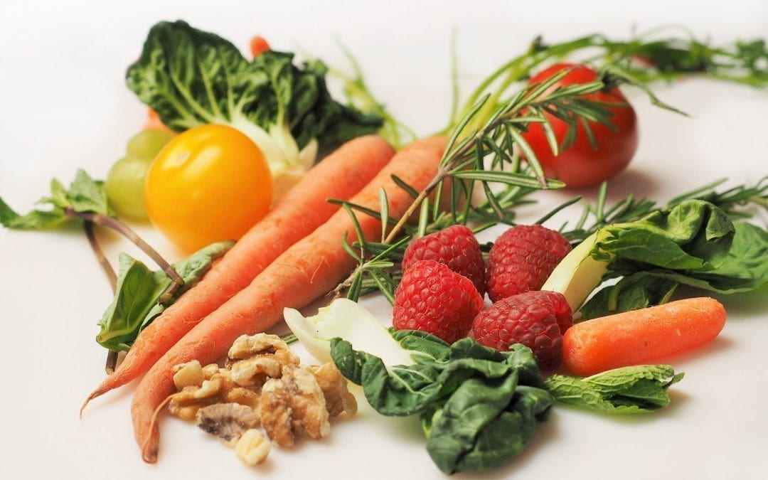 Is veganism the answer. Some healthy looking vegetables, carrots, etc.